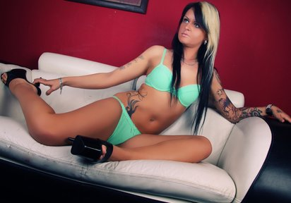 Sexy tattooed Colleen stretching out tight body in seductive green panties and bra.